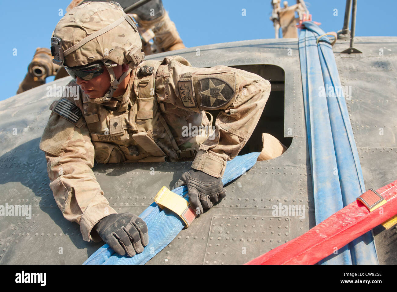 Spc. Rodrigo Medina, who serves as a stryker maintainer and recovery operator with the Logistical Support Team, - Stock Image