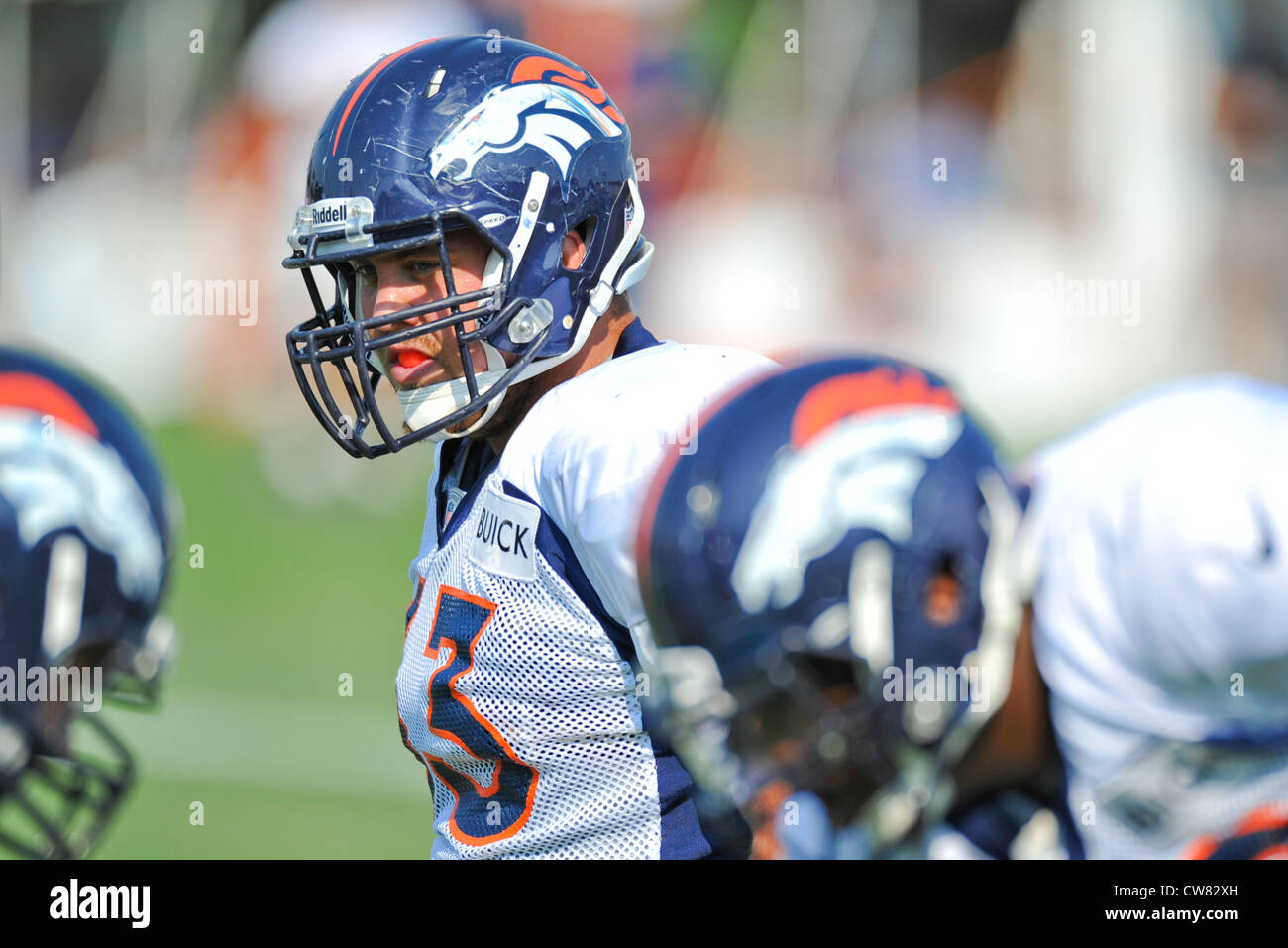 Benjamin Garland, Denver Broncos defensive end, gets ready for the next drill during a training camp session Aug. - Stock Image