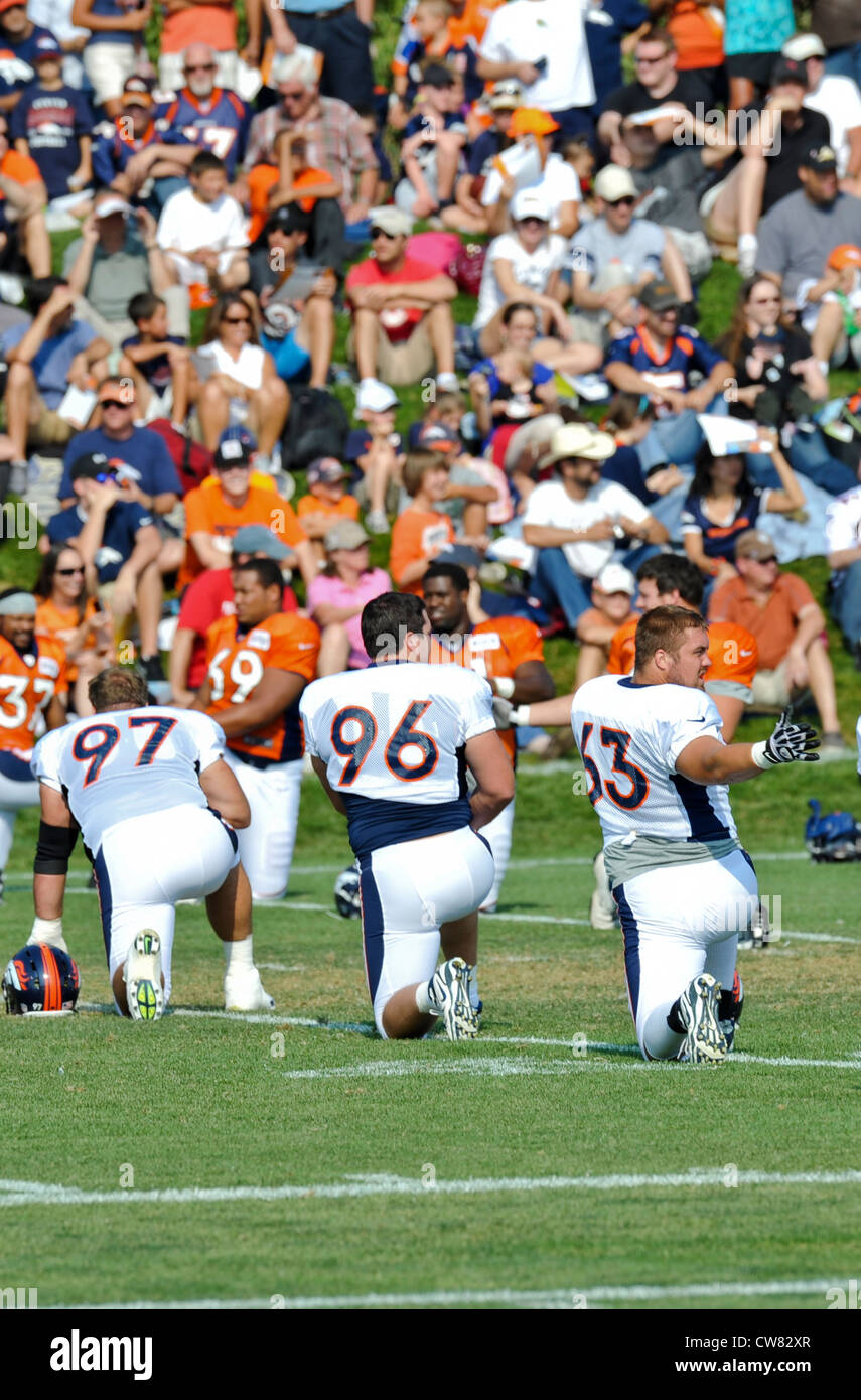 Benjamin Garland, 63, Denver Broncos defensive end, stretches during training camp Aug. 14, 2012 at the Broncos - Stock Image