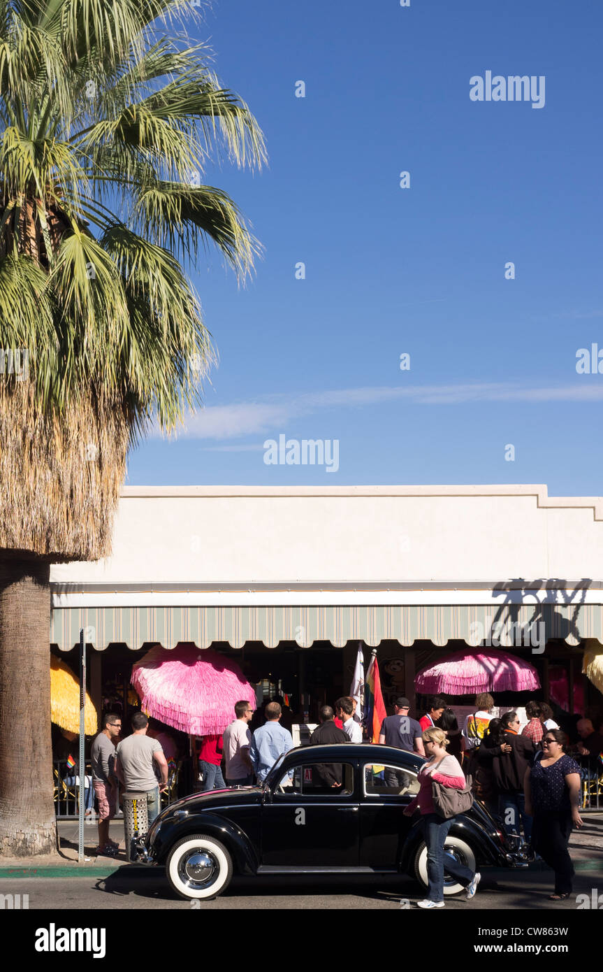 A black Volkswagen beetle is parked in front of a popular restaurant in Palm Springs, California. Stock Photo
