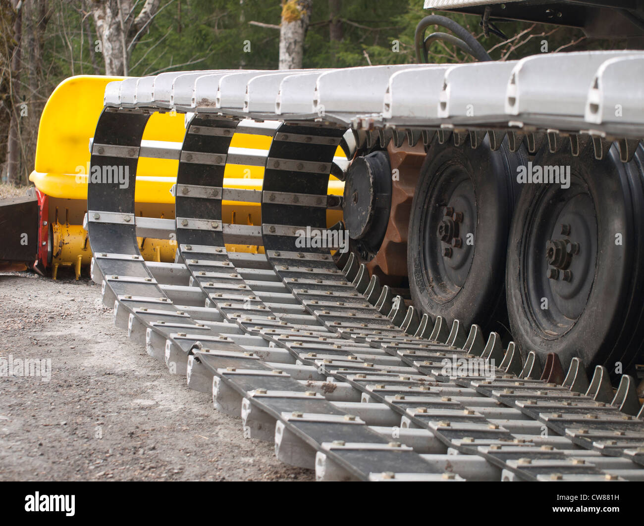 Continuous tracks or caterpillar tracks of an all terrain vehicle used for preparing ski tracks and a ski jump hill - Stock Image