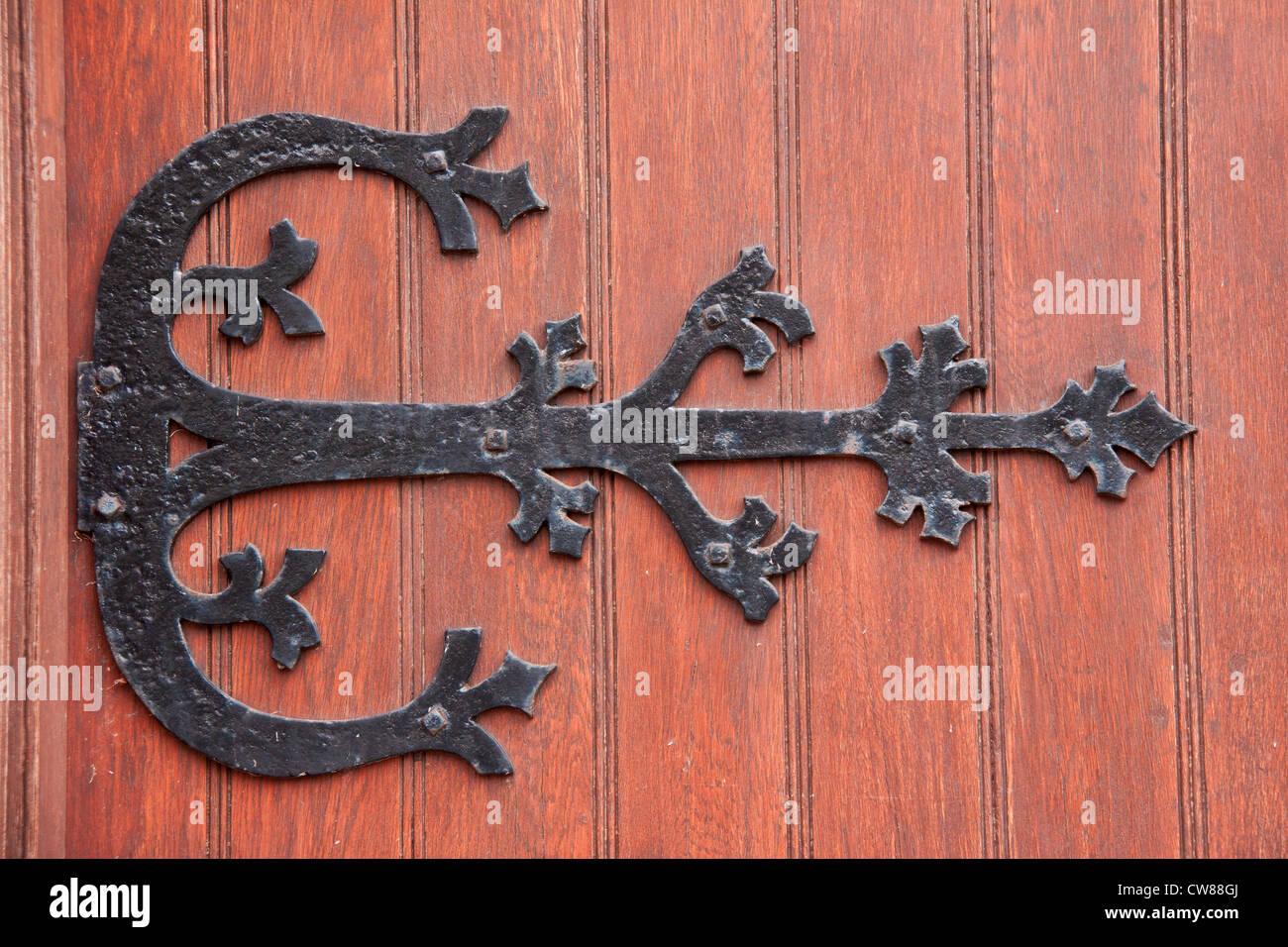 Wrought iron door decoration fixed on a massive wood door Stock Photo