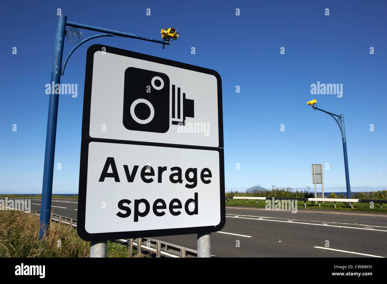 average speed road safety overhead traffic cameras and warning sign scotland uk united kingdom - Stock Image