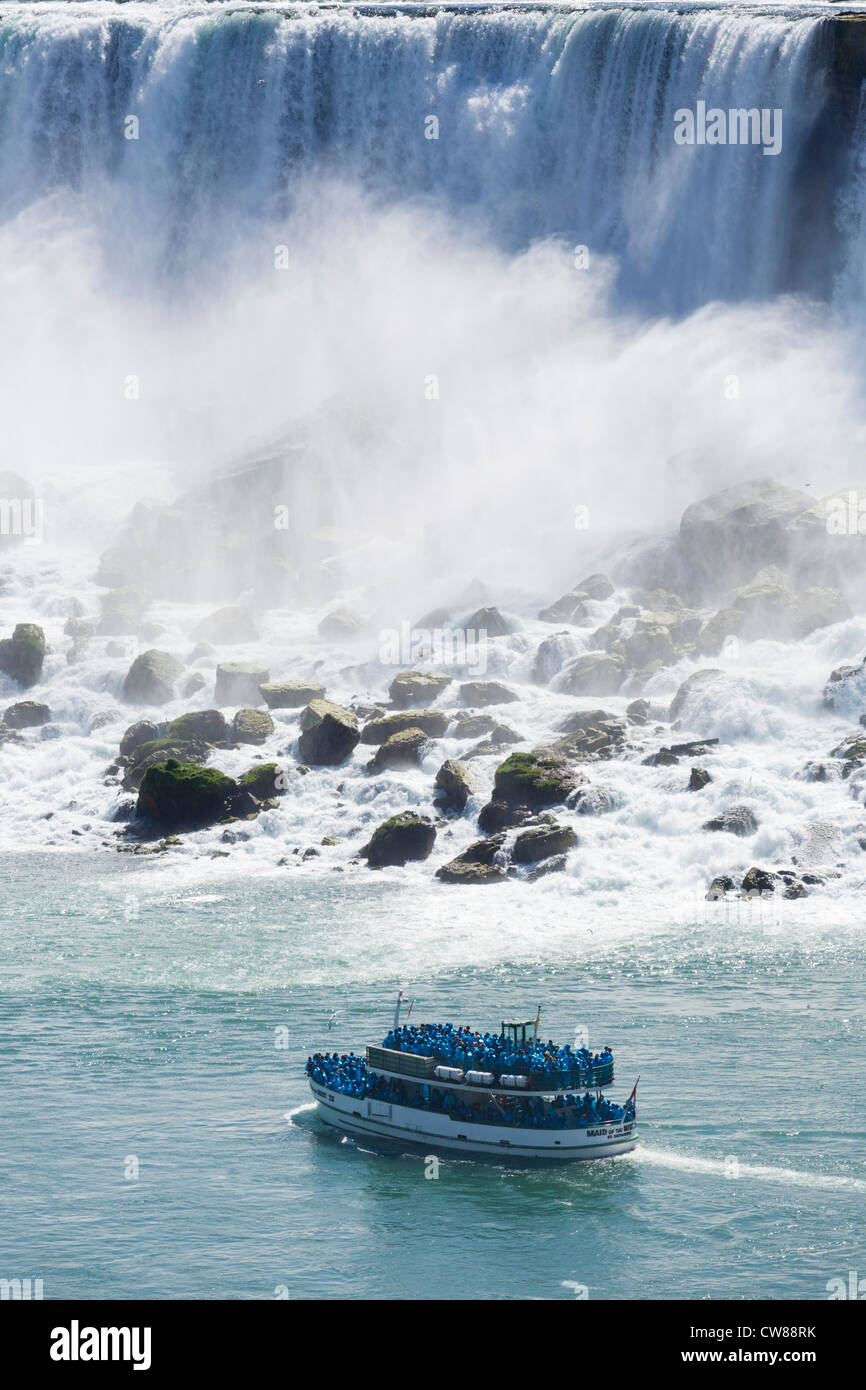 Maid of the Mist tour boat in front of the American Falls viewed from the Canadian side, Niagara Falls , Ontario, - Stock Image
