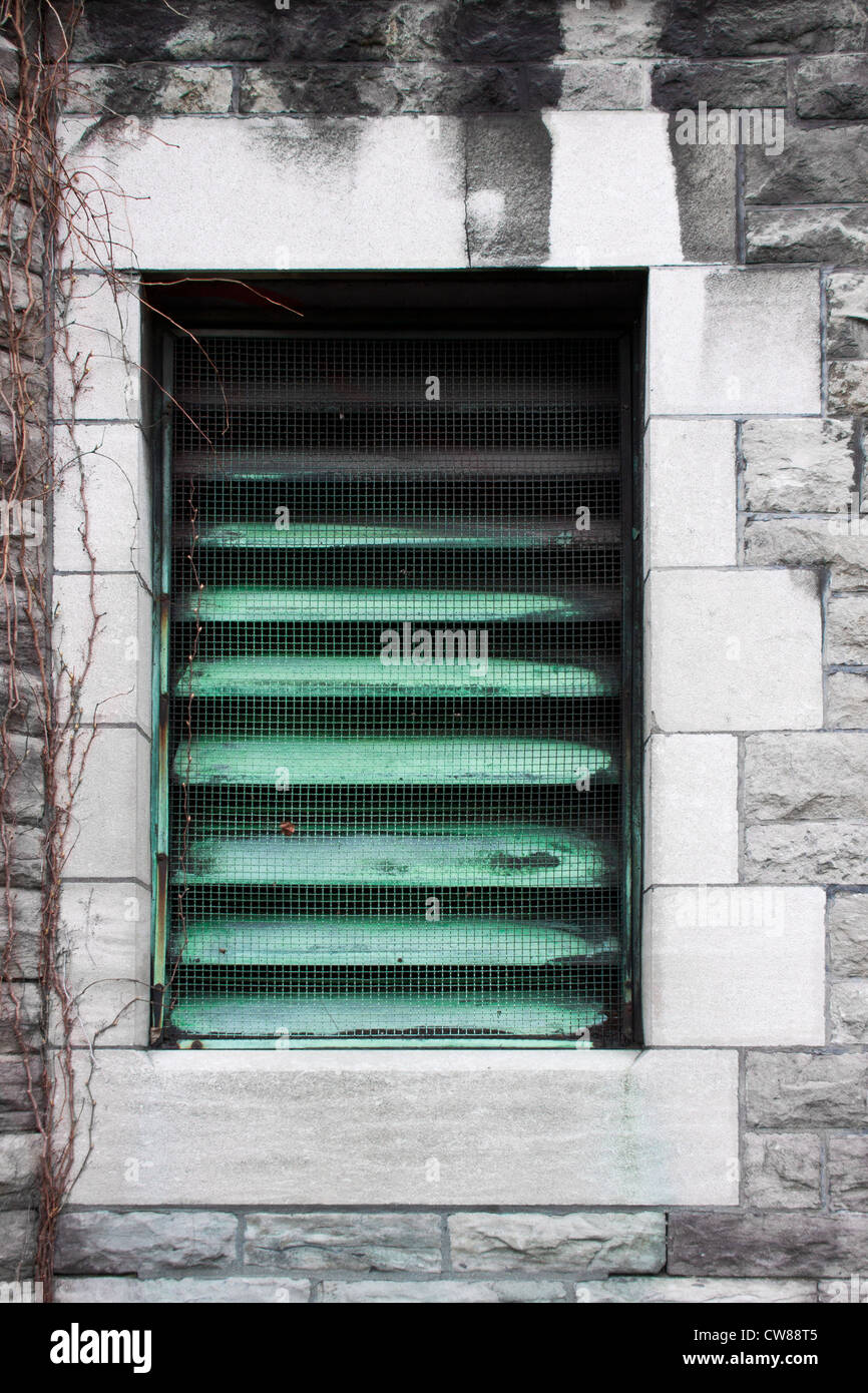 Window converted in a radiator grill, a beautiful element of architecture of an old building and a piece of air Stock Photo