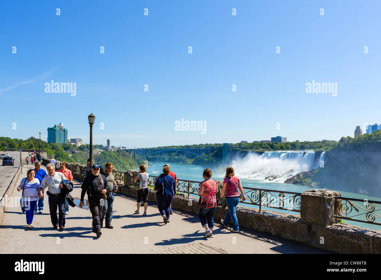 Tourists on path with the American Falls behind, Niagara Falls , Ontario, Canada - Stock Image