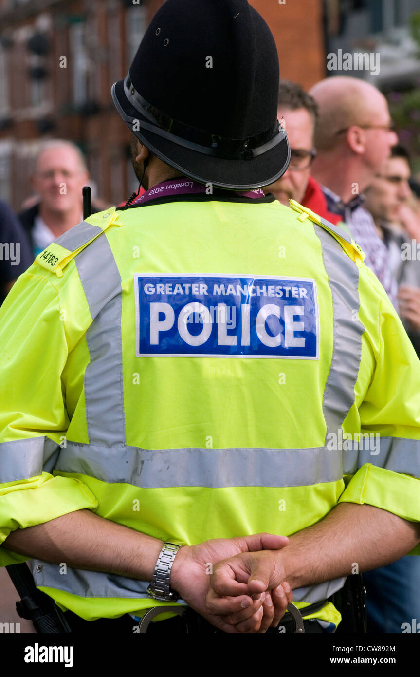 A Greater Manchester police officer on crowd duty at a football match in England, UK Stock Photo