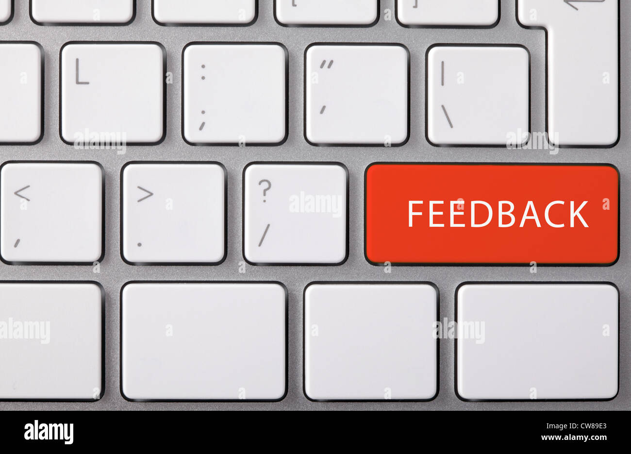 Laptop keyboard and red key 'FEEDBACK' on it. - Stock Image