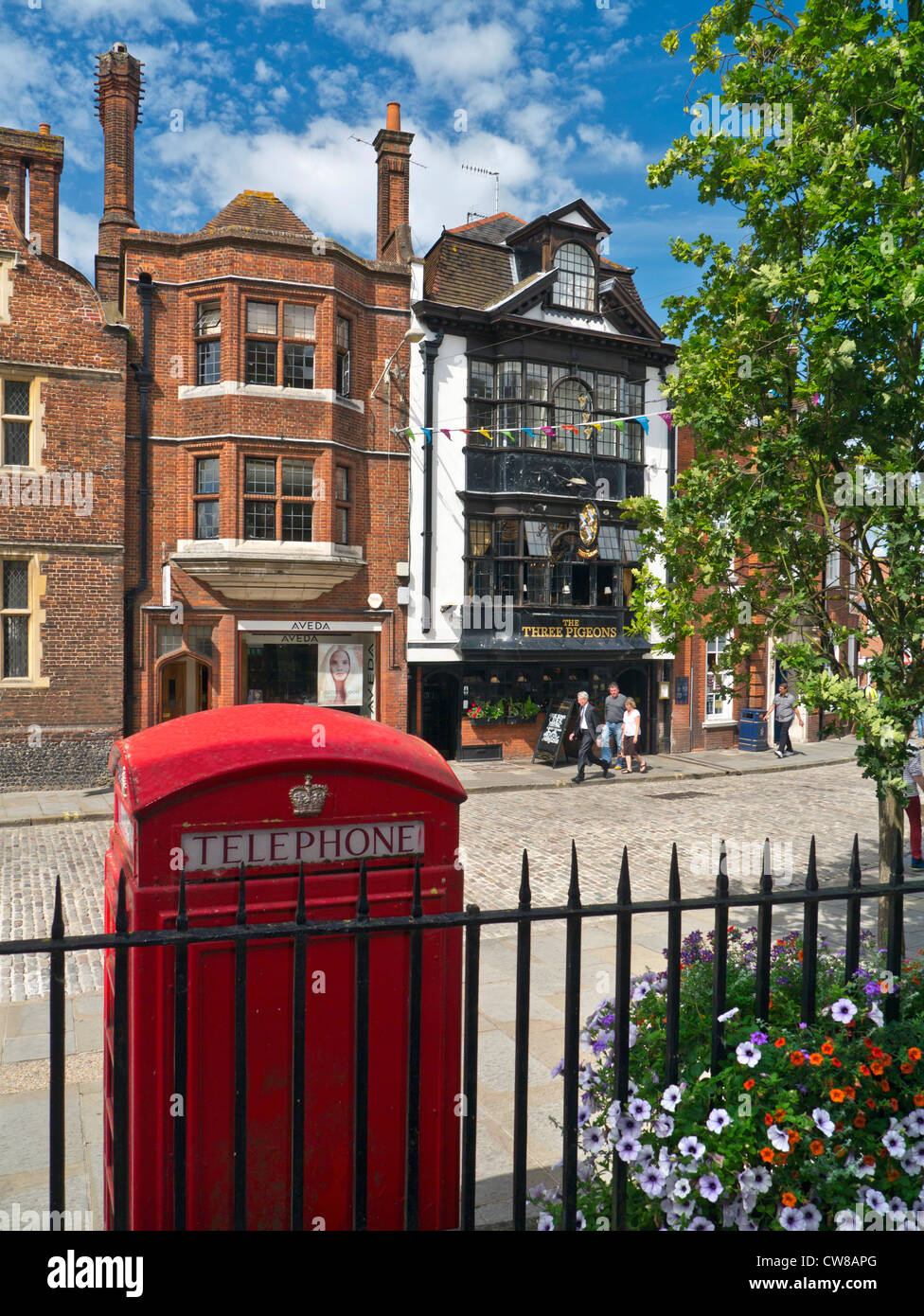 Guildford High Street with traditional red telephone box and historic Three Pidgeons public house behind Guildford - Stock Image