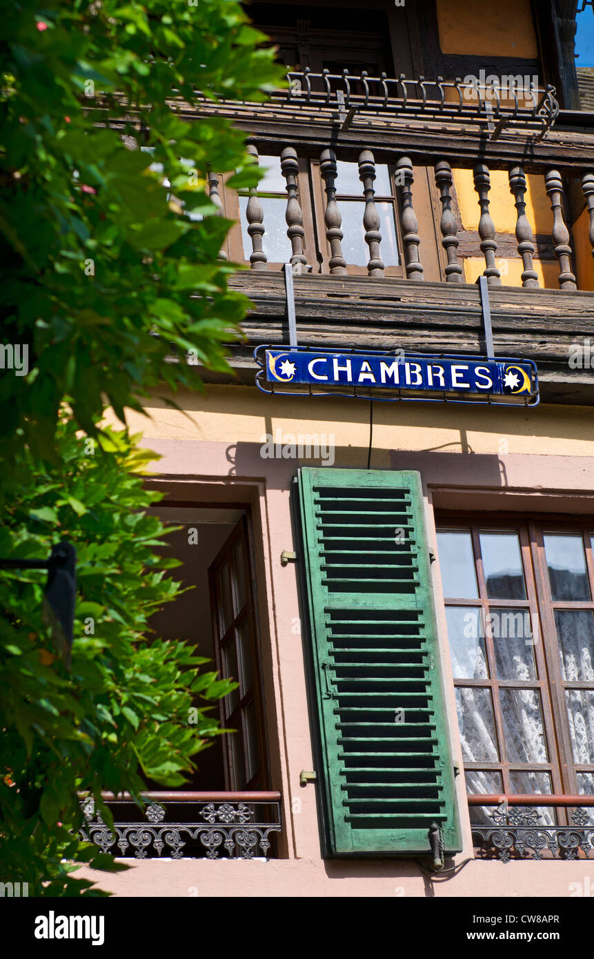 French B&B Typical rustic charming French B+B Gite 'Chambres' sign with typical window shutters Stock Photo