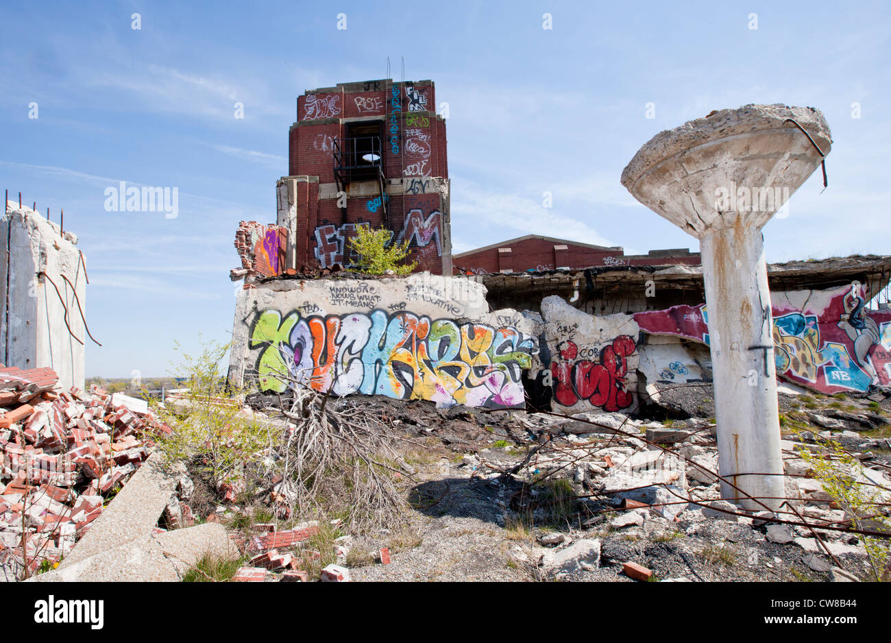 Roof top of an abandoned car manufacturing plant in Detroit Michigan. The ceiling supports have toppled over graffiti Stock Photo
