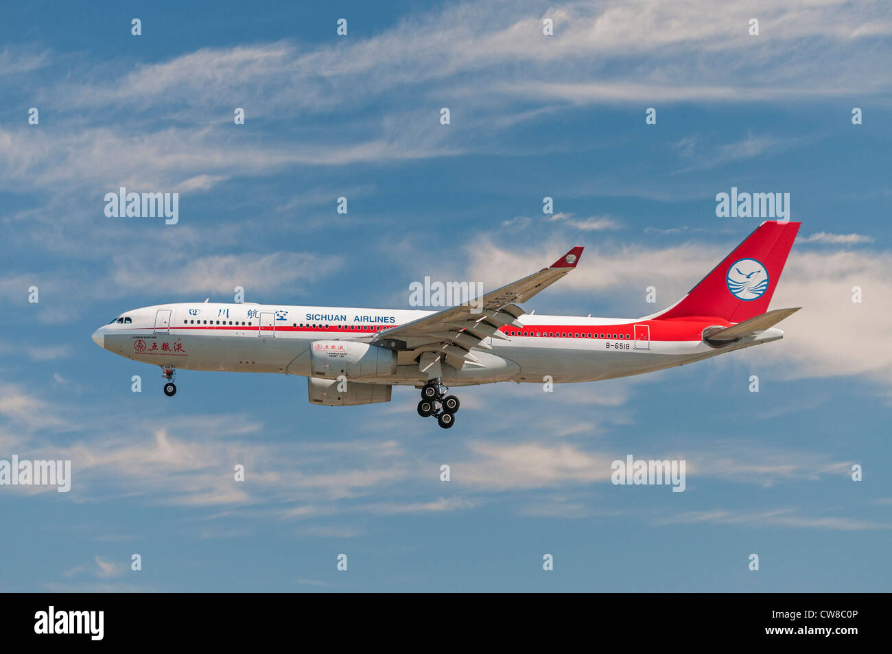A Sichuan Airlines Airbus A330-200 jetliner on final approach for landing - Stock Image