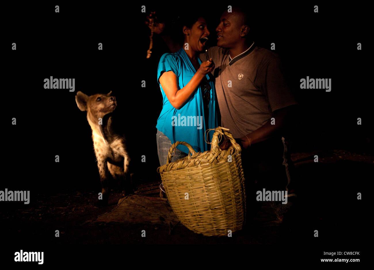 Hyena Man with tourist Harar Ethiopia. - Stock Image