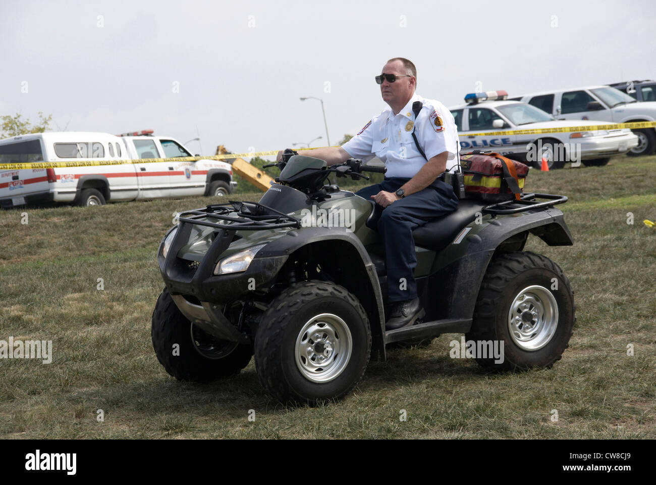 A Medic on a 4 wheel dirt bike patrols for medical emergencies at a festival in Bladensburg, Maryland - Stock Image