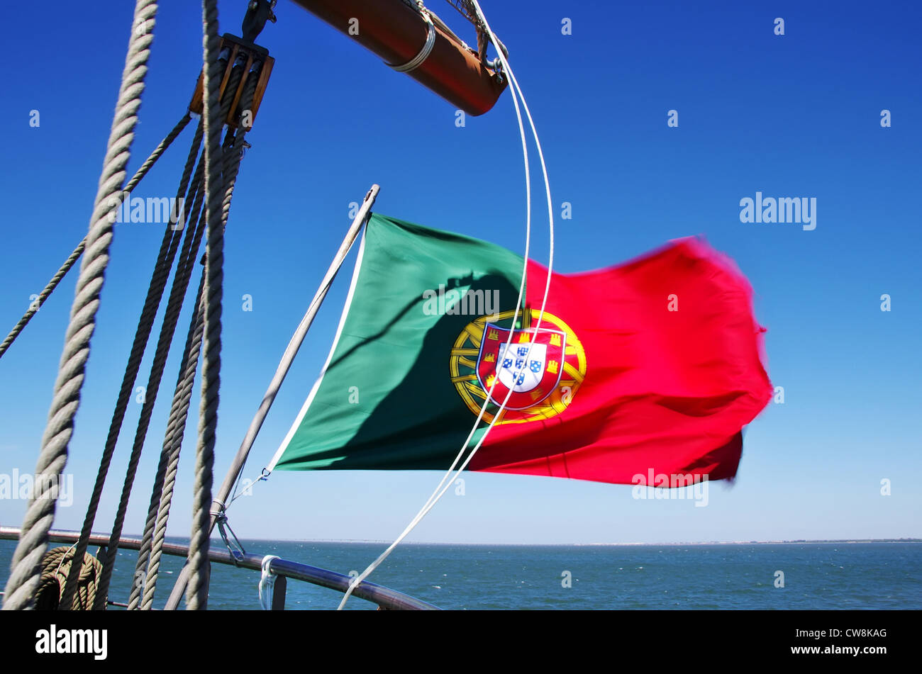 Portuguese flag on sailboat - Stock Image