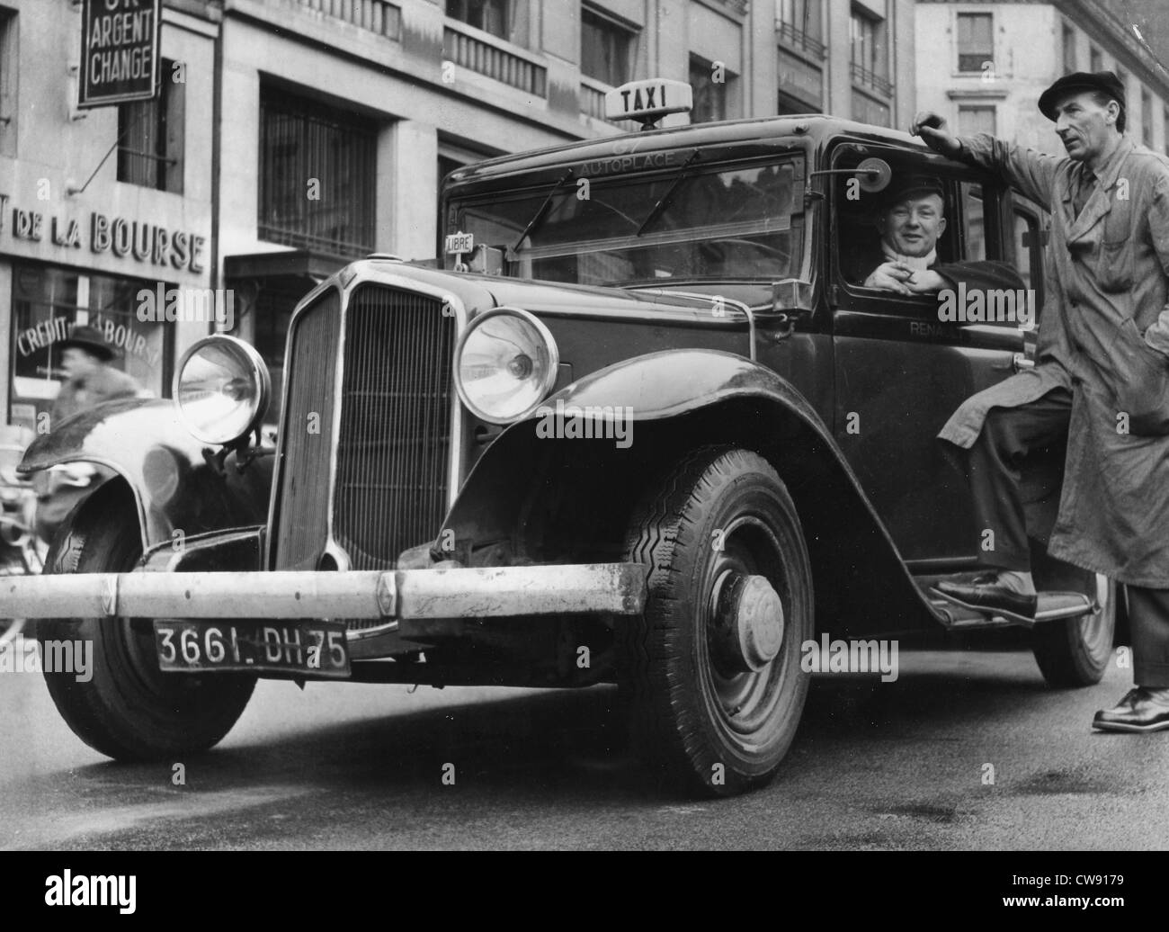 A G7 taxi parked at Bourse square in Paris - Stock Image