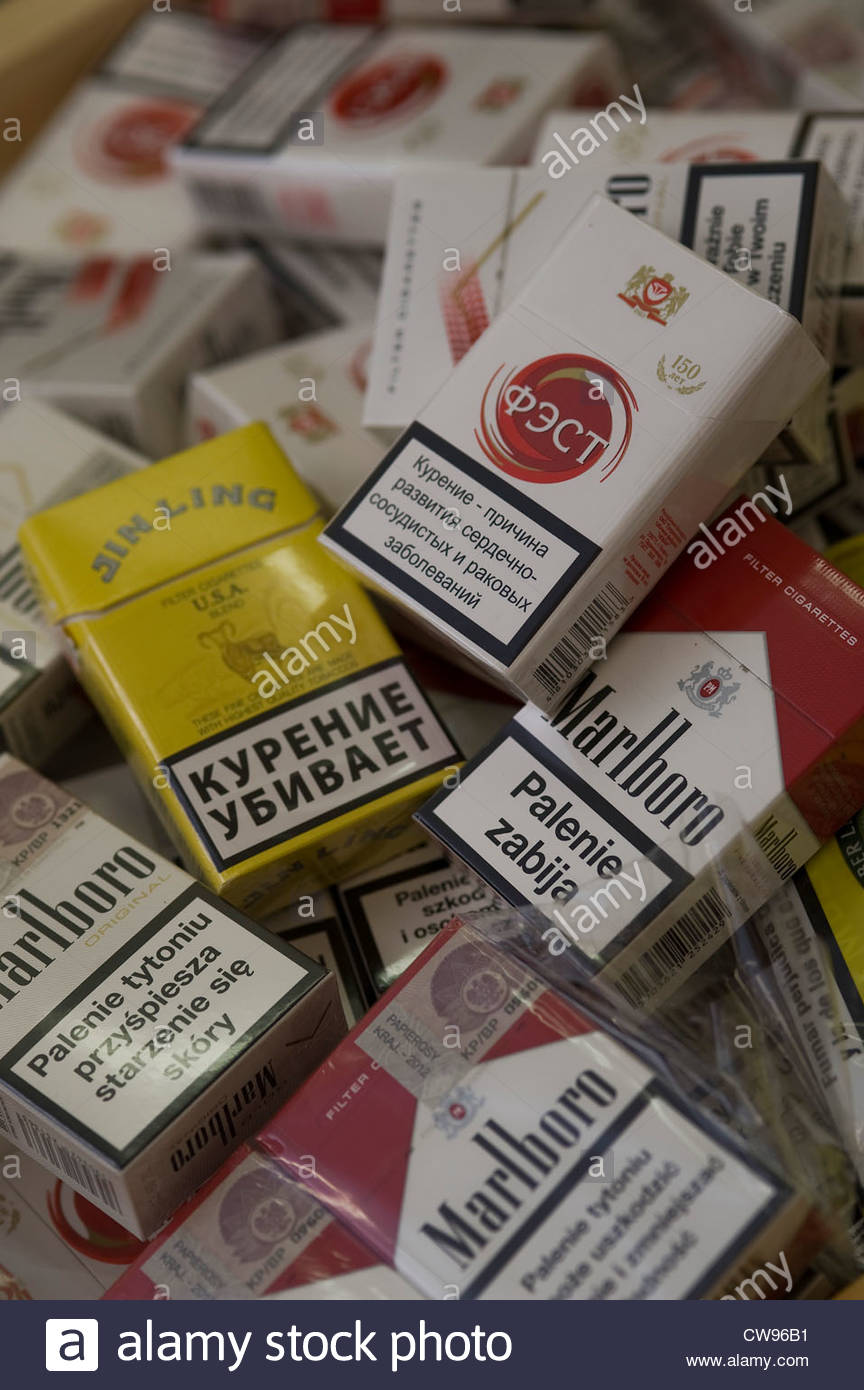 Contraband & Counterfeit cigarettes uncovered by Trading Standards during a raid on a newsagents in the UK. - Stock Image