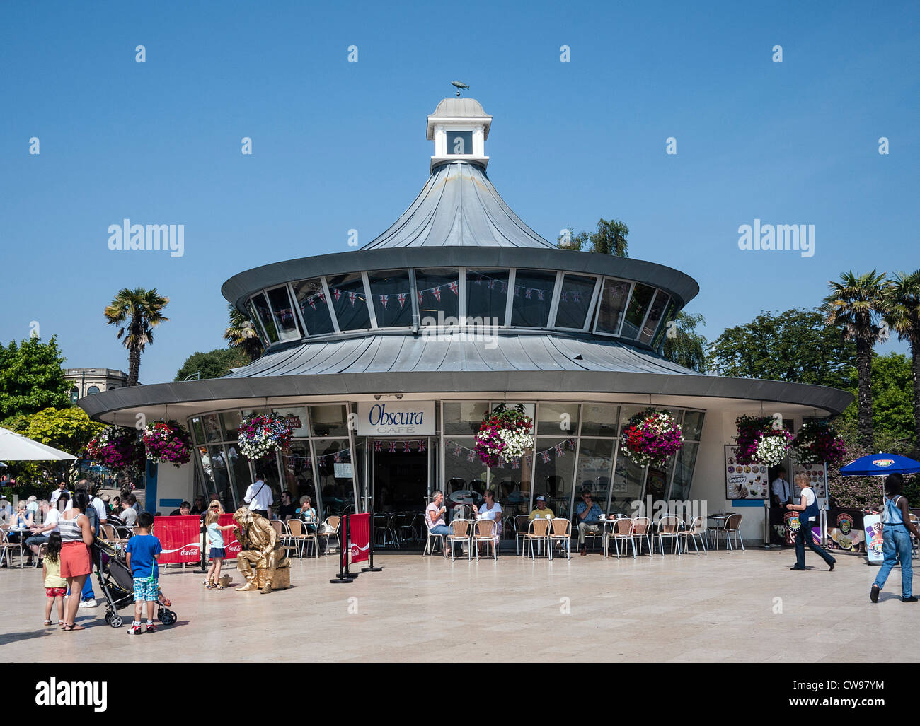 Bournemouth Square, Obscure Cafe, people walking and sitting, Dorset, England, UK. - Stock Image