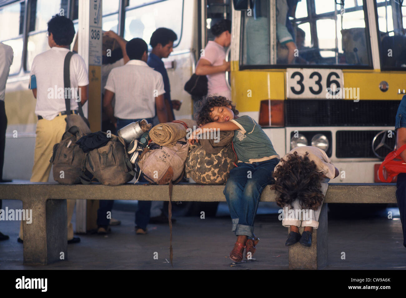 Homeless family with possessions at bus station Brazilia Brazil South America. HOMER SYKES - Stock Image