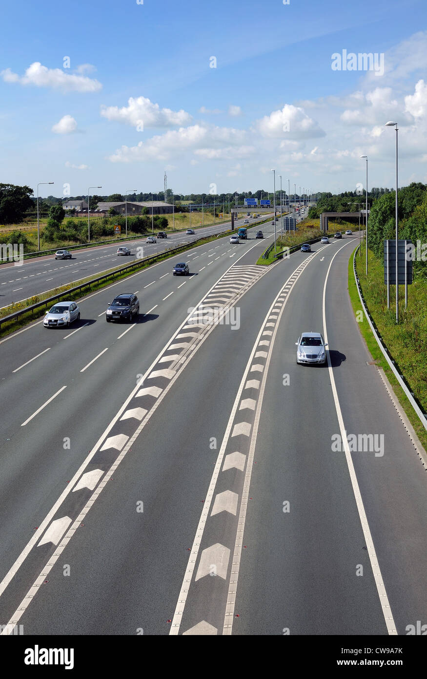 motorway with old style central reservation barrier before upgrade in safety standards - Stock Image