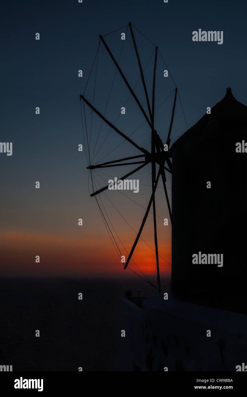 Windmill at sunset in Greece - Stock Image