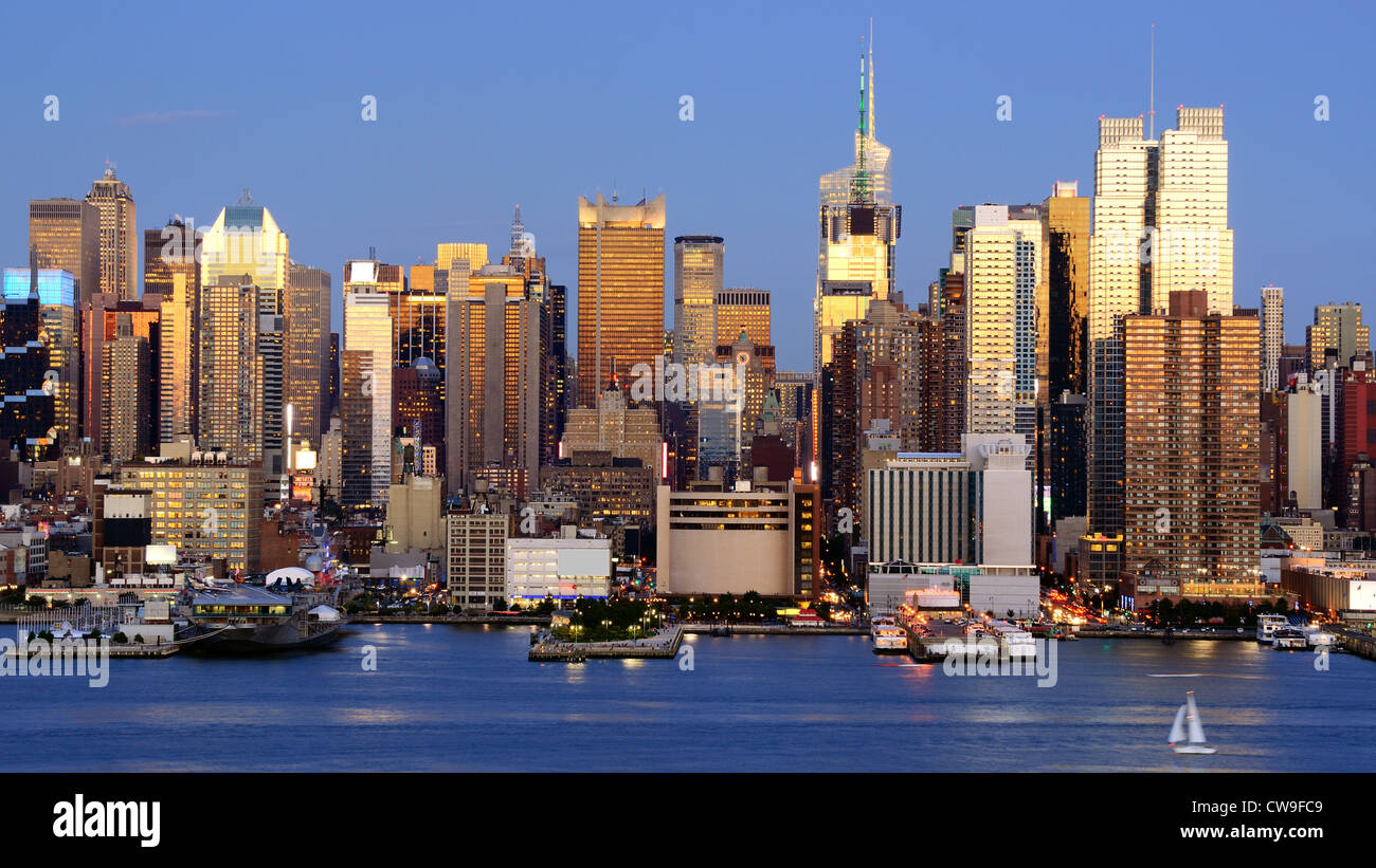 Skyline and modern office buildings of Midtown Manhattan viewed from across the Hudson River. Stock Photo