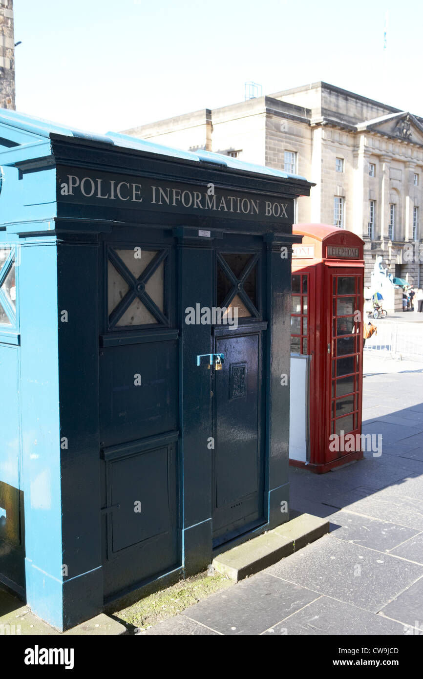 old blue police information box and red telephone box on lawnmarket on the royal mile edinburgh scotland uk united - Stock Image