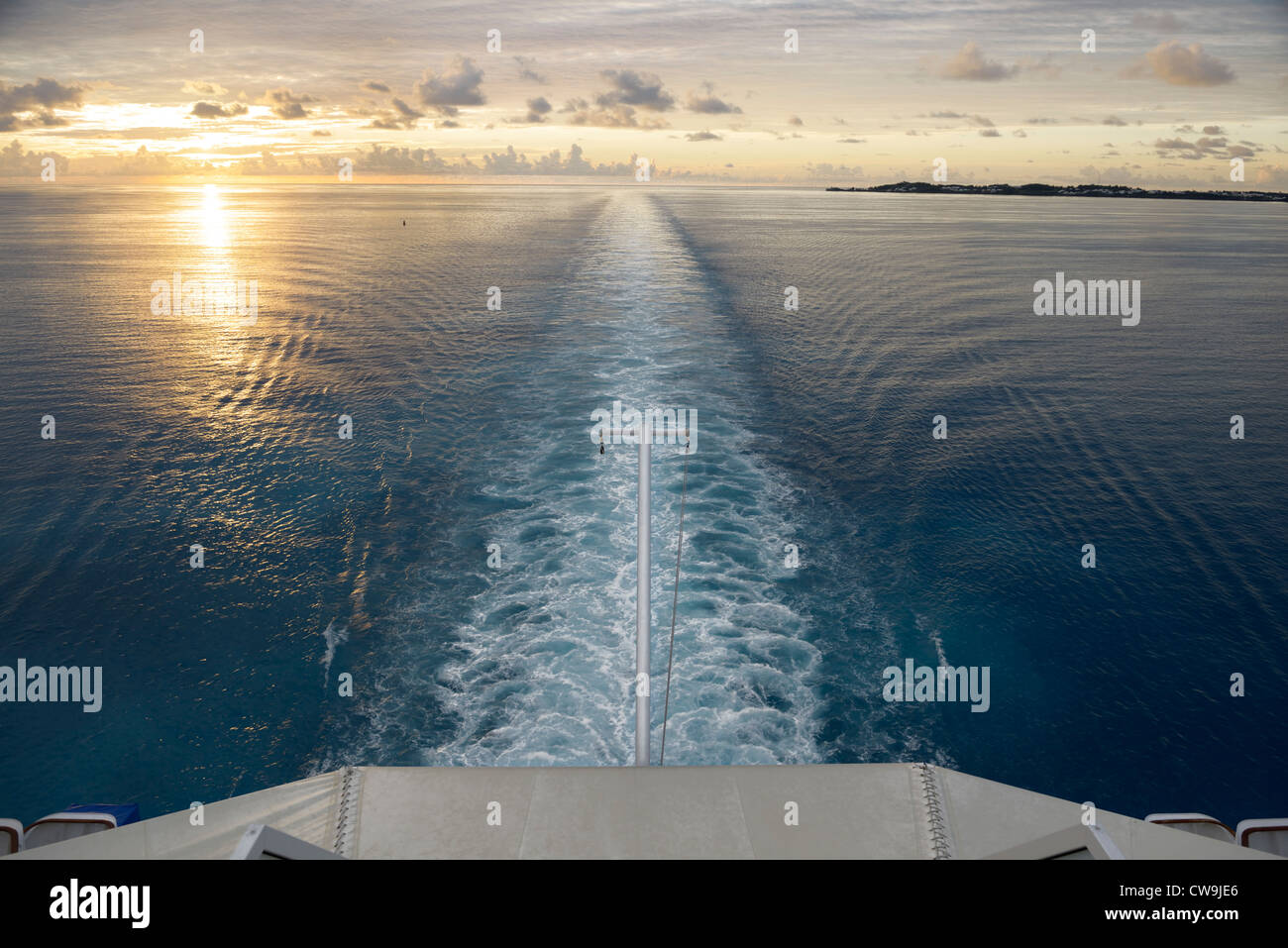 View from the stern of a cruise ship at sea with sunset - Stock Image