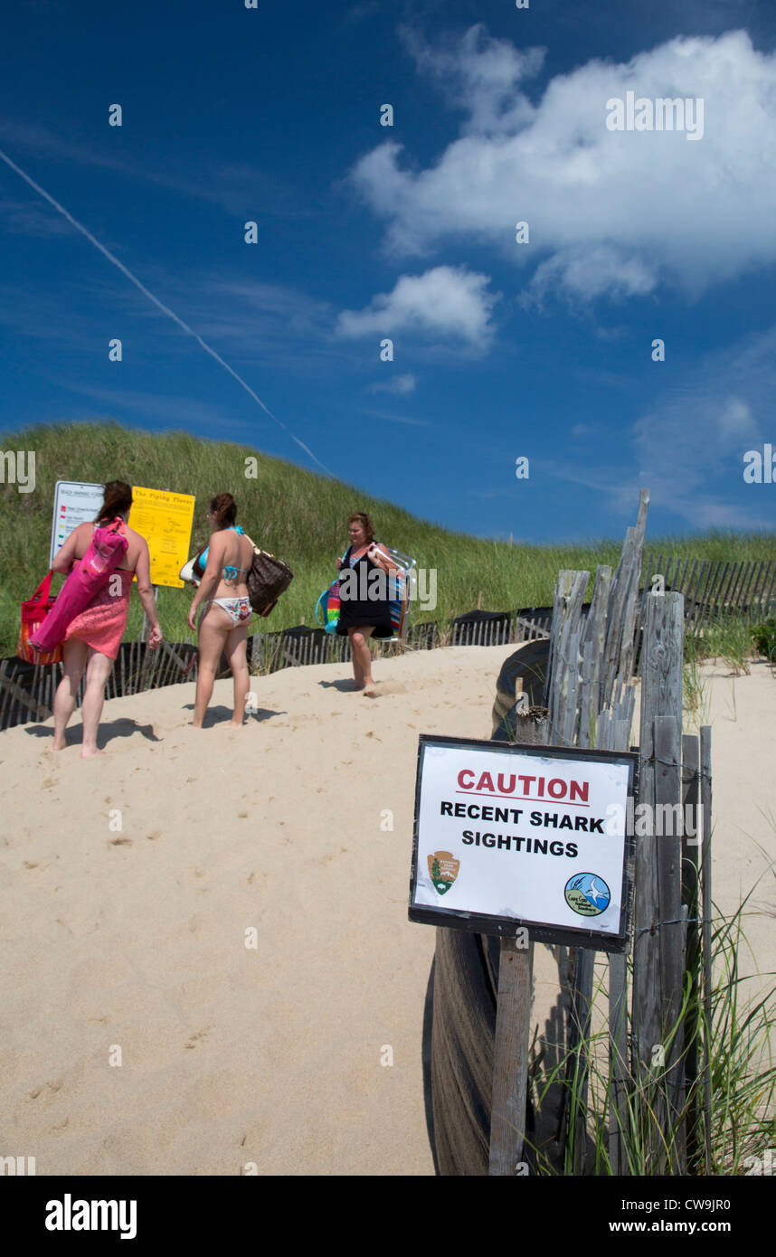 Truro, Massachusetts - A sign warns of recent shark sightings at Head of the Meadow Beach in Cape Cod National Seashore. Stock Photo