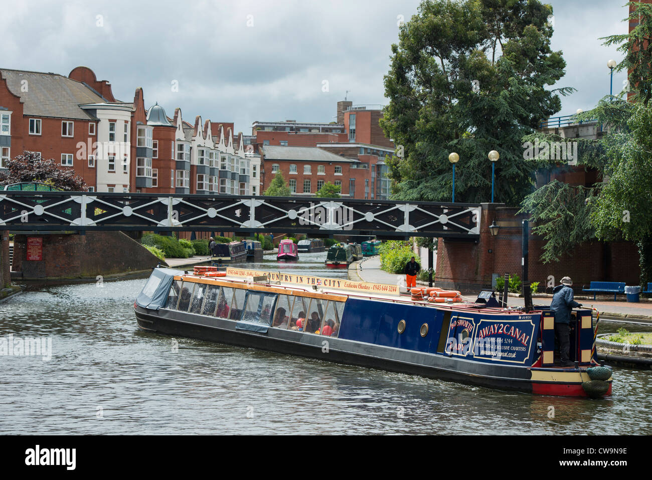 A barge on the canal in near to Brindleyplace - Stock Image