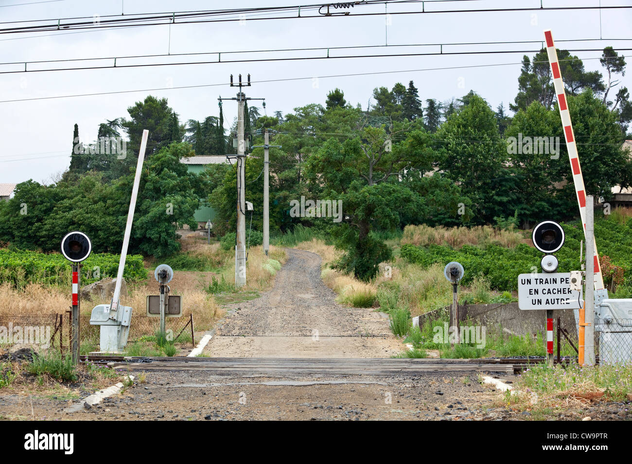 An unmanned level crossing in the South of France Stock Photo