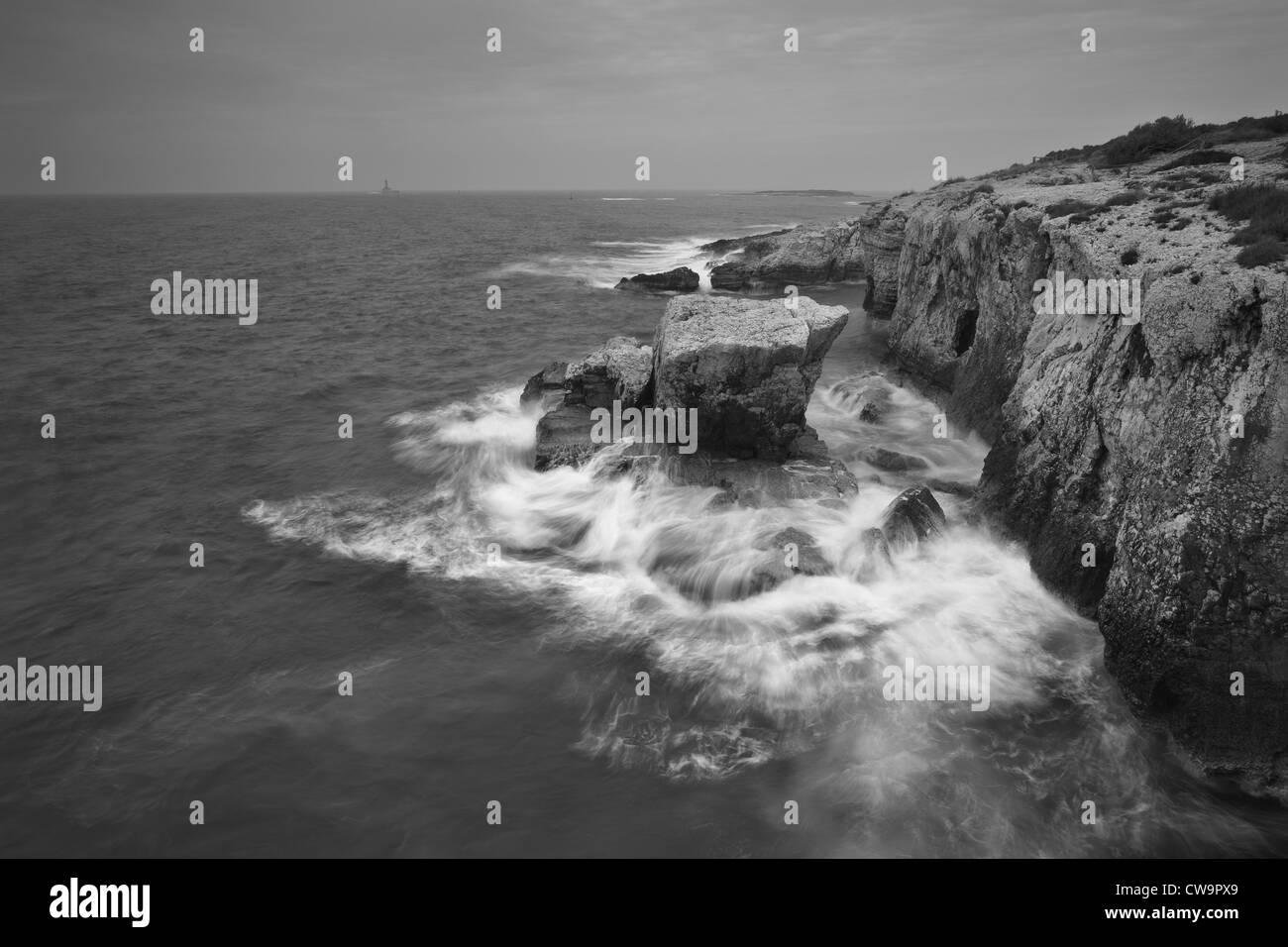 Waves breaking on a solid rock, Cape Kamenjak, Istria, Croatia - Stock Image