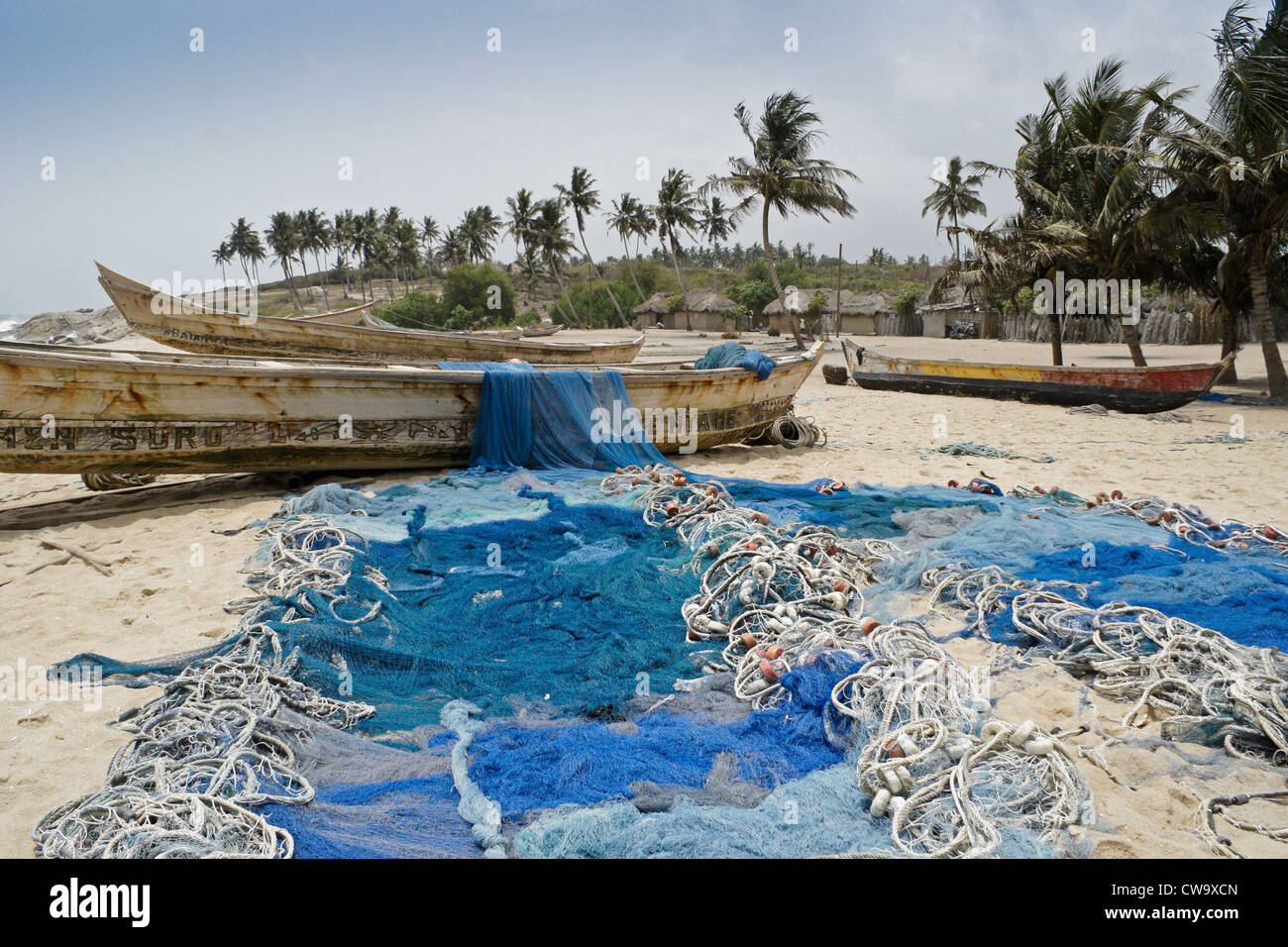 Fishing Boats And Nets On Beach Kortankore Village Ghana Stock