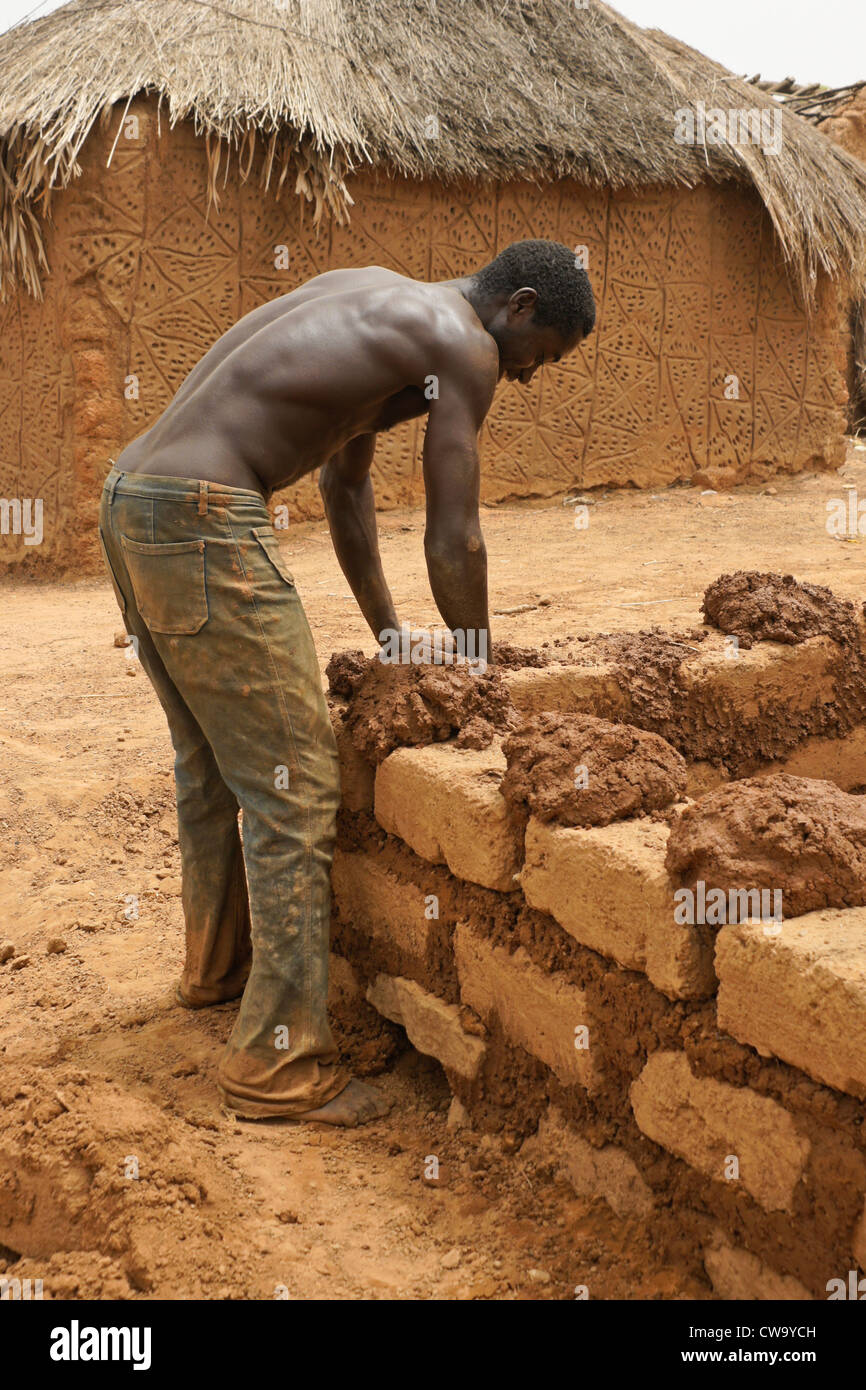 Man Building Mud Brick House In Mognori Eco Village Ghana