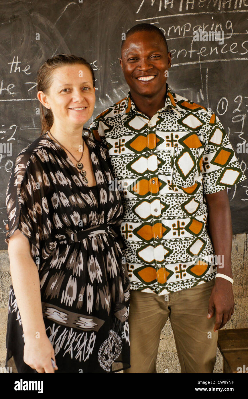 NGO volunteers who help poor women in Ghana learn a skill that provides income - Stock Image
