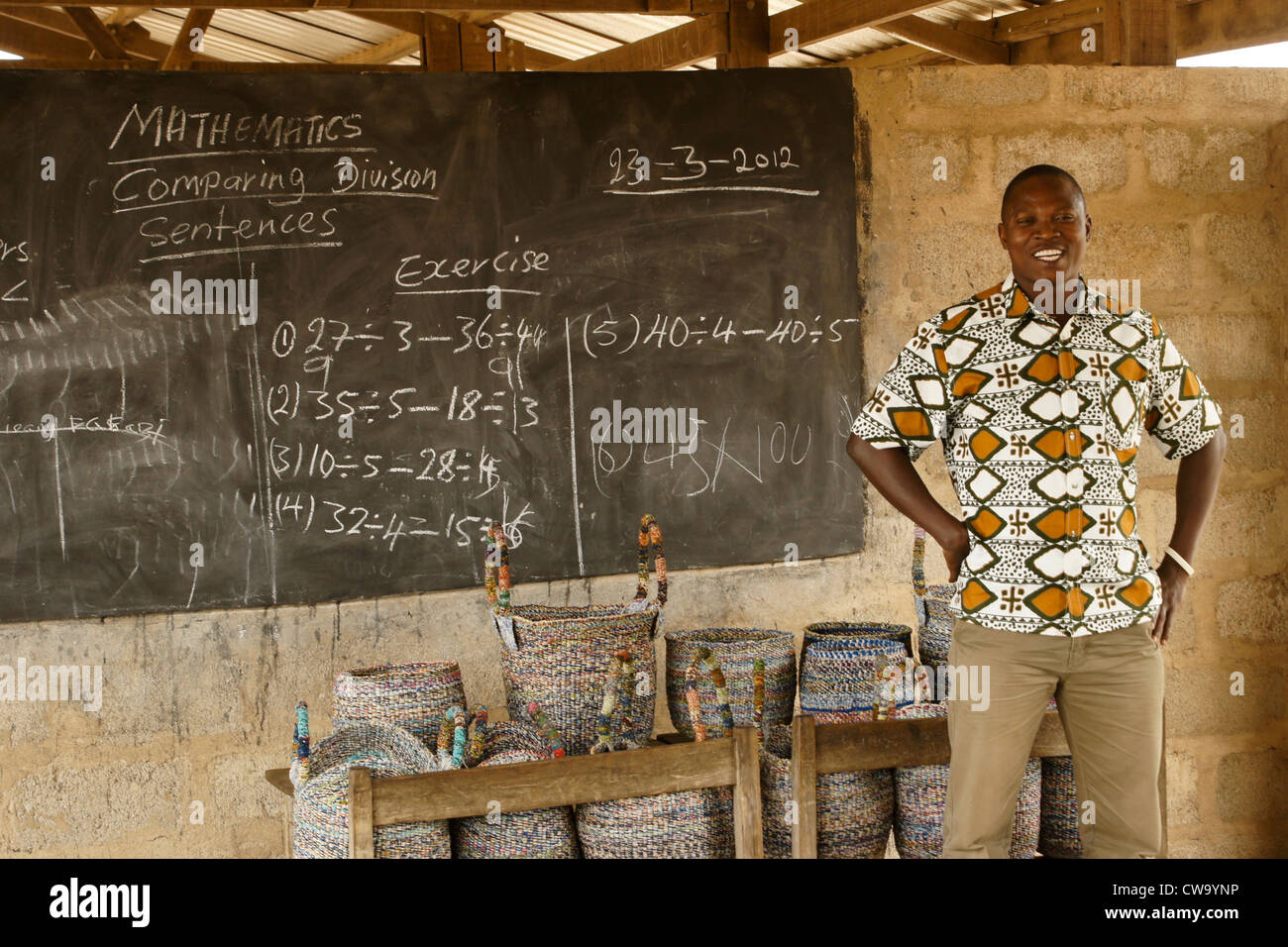 NGO volunteer who helps poor women in Ghana learn a skill that provides income - Stock Image