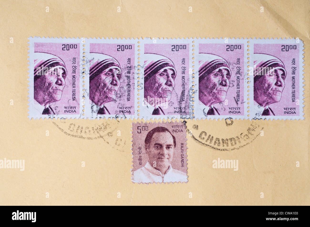 Indian stamps with pictures of Mother Teresa and Rajiv Gandhi on a letter with Chandigarh stamp - Stock Image