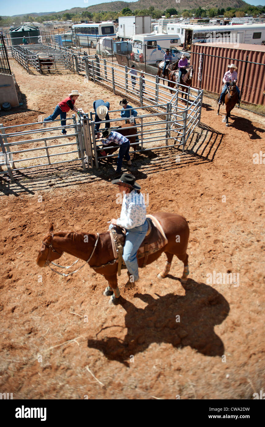 Men and women on horseback waiting at the chutes for their call ar the Mount Isa Rodeo in Outback Queensland - Stock Image