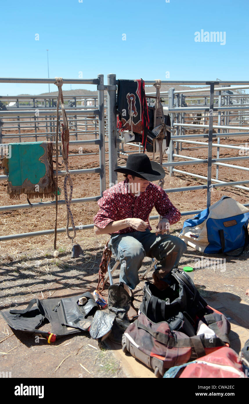 Cowboy preparing himself at the stockyard for the bullriding contest of the Mount Isa Rodeo, Outback Queensland - Stock Image