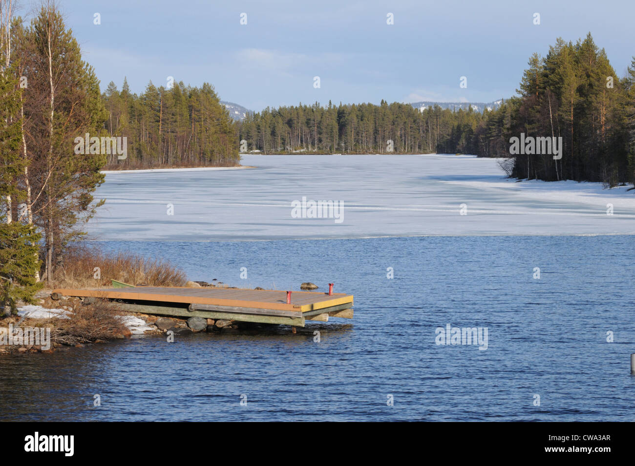 typical Finnish lake frozen in the Karelia region near the artic circle - Stock Image
