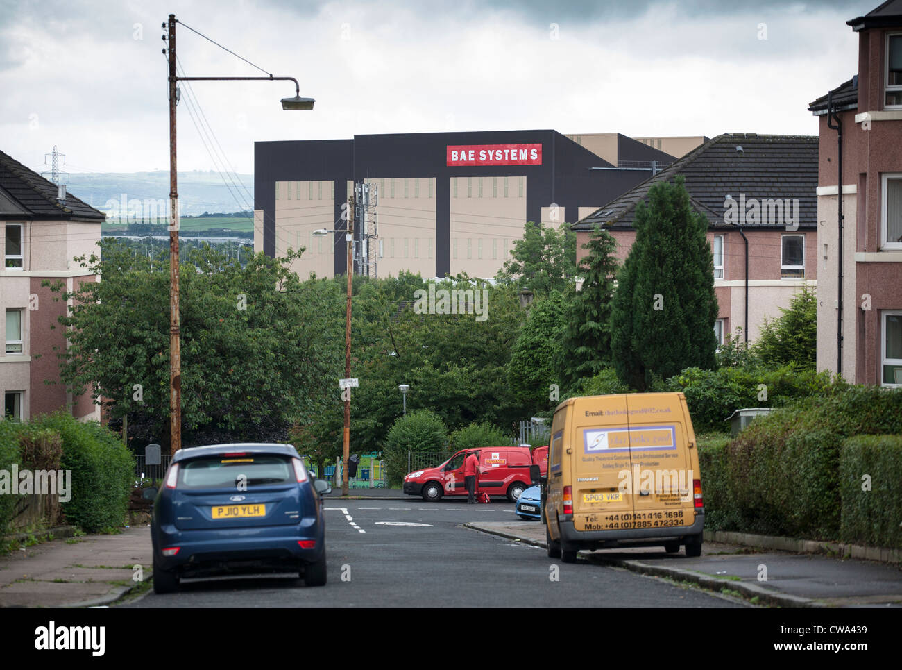A view of the BAE Systems complex on the river Clyde from the Scotstounhill area of Glasgow. - Stock Image