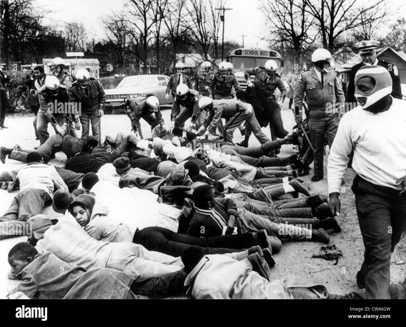 CIVIL RIGHTS, Social Circle, Georgia, State troopers arrest demonstrators blocking the path of a school bus protesting - Stock Image