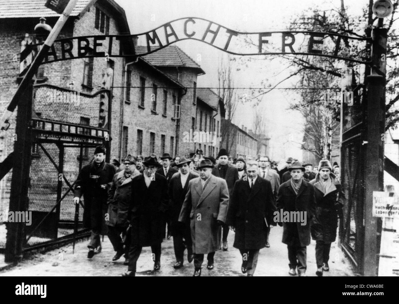 Members of the Frankfurt war crimes court leave the Auschwitz death camp. Judge Walter Hotz (center), director of - Stock Image