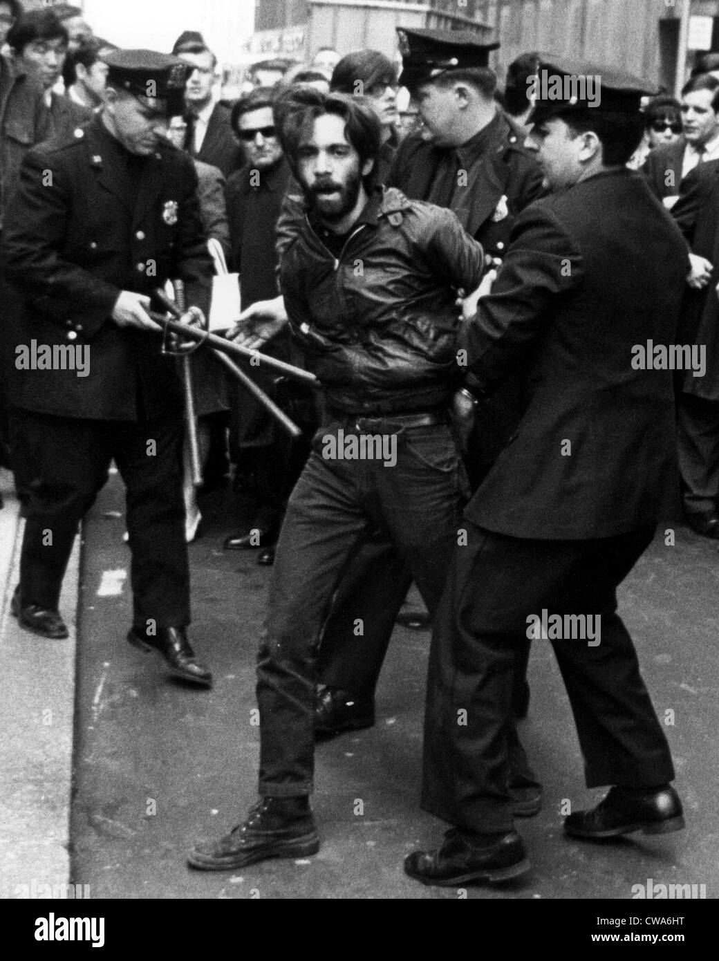 DEMONSTRATION, NEW YORK: Policemen walk off a demonstrator in front of the Associated Press building during a demonstration - Stock Image