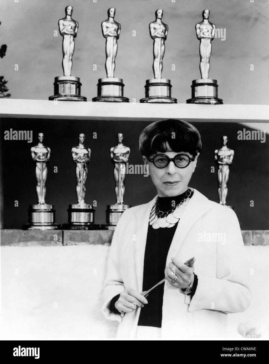 EDITH HEAD, surrounded by the eight Oscars she has won during a distinguished career. 1976. Courtesy: CSU Archives - Stock Image