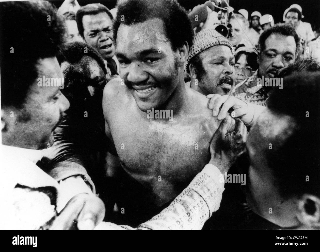 GEORGE FOREMAN- The boxer is congratulated in the ring after defeating Joe Frazier for the world heavyweight championship. - Stock Image