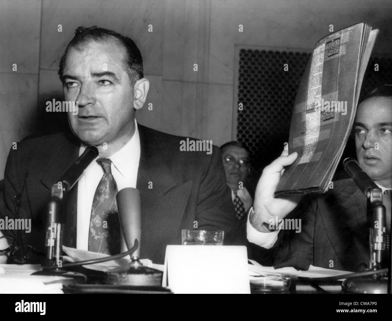 WASHINGTON: Sen. Joseph R. McCarthy (R. Wisc) holds up a copy of the Army's charges against him as he interrogates - Stock Image