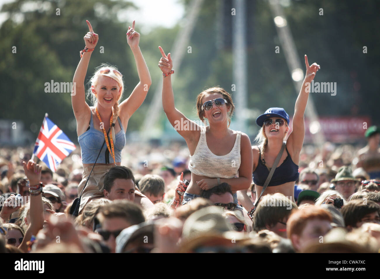 Girls in the crowd enjoying the live music at the V Festival in Hylands Park, Chelmsford, Essex - Stock Image