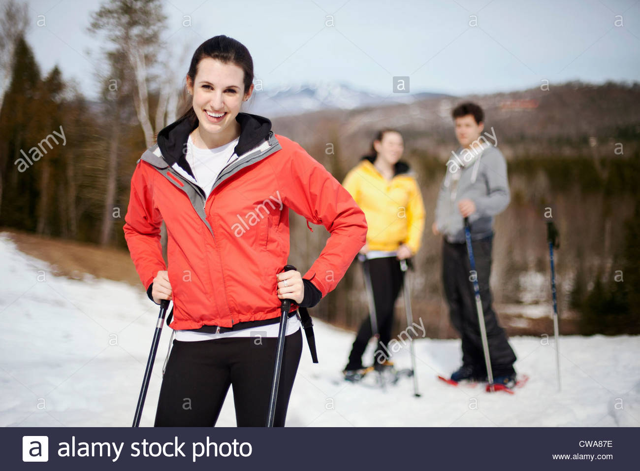 Young woman with ski poles - Stock Image