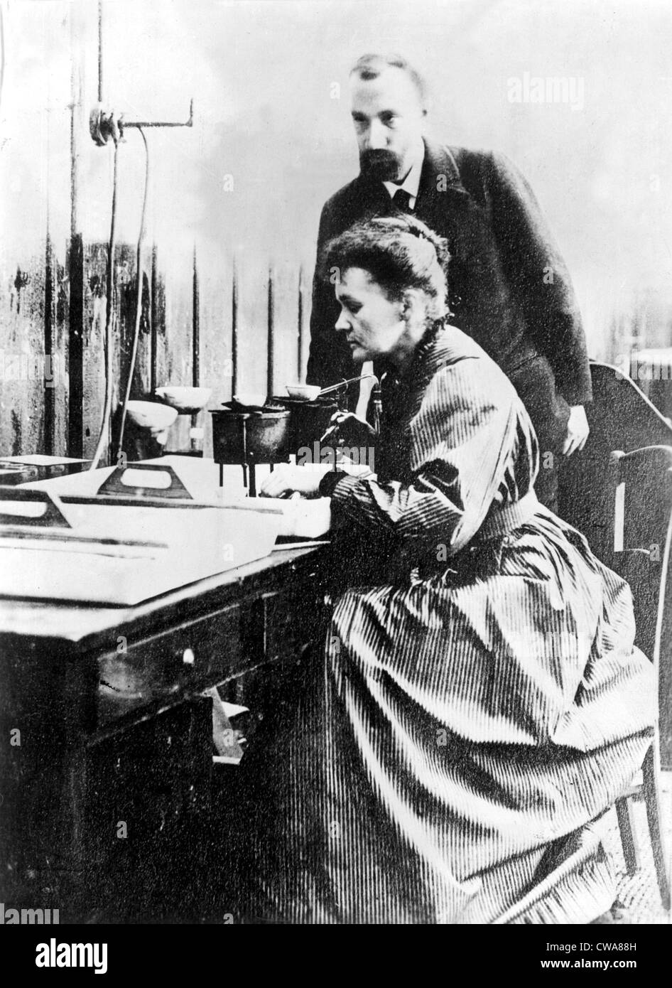 Marie and Pierre Curie, shown in their Paris laboratory in 1904.. Courtesy: CSU Archives / Everett Collection - Stock Image